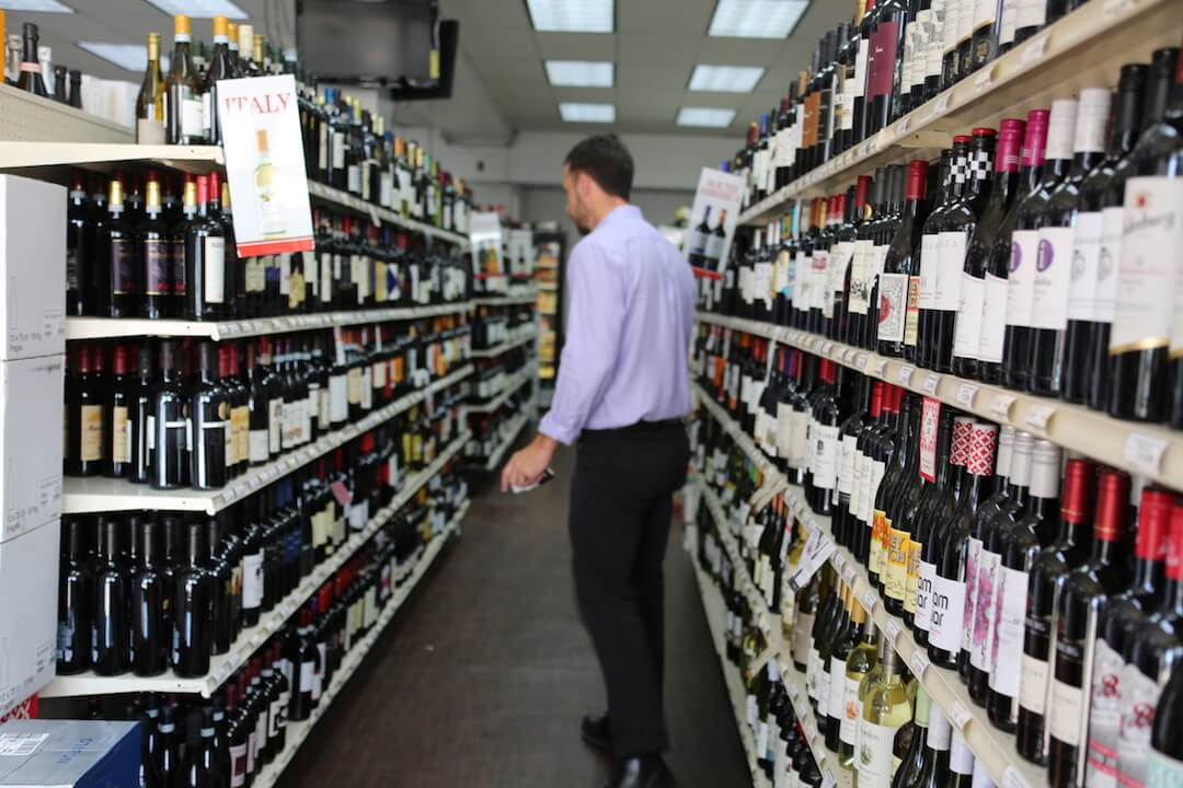 man stocking up on wine