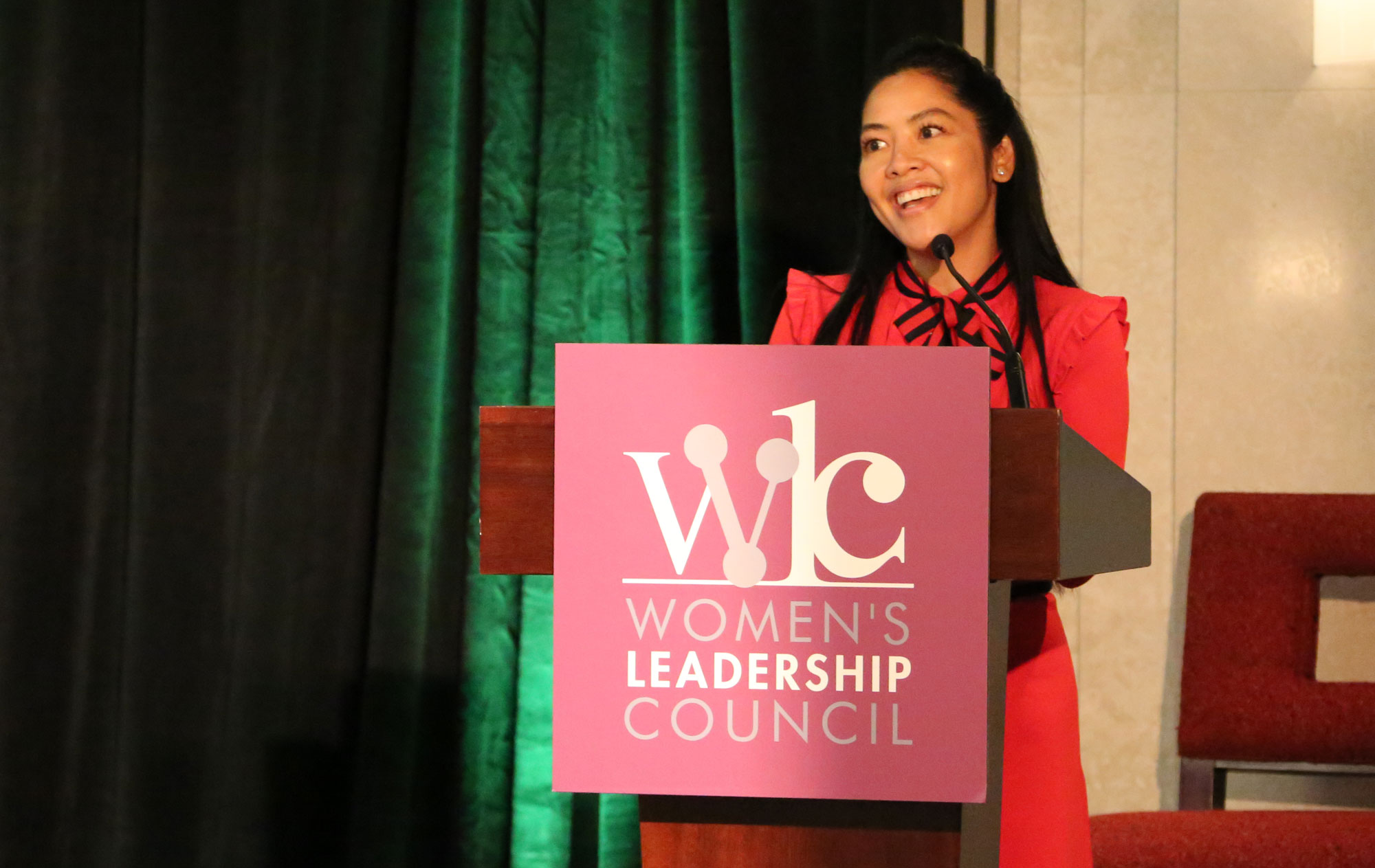 Philana presents to attendees at the inaugural Women's Leadership Council Conference in 2017.