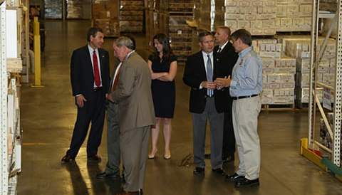 Group of people meeting on warehouse floor